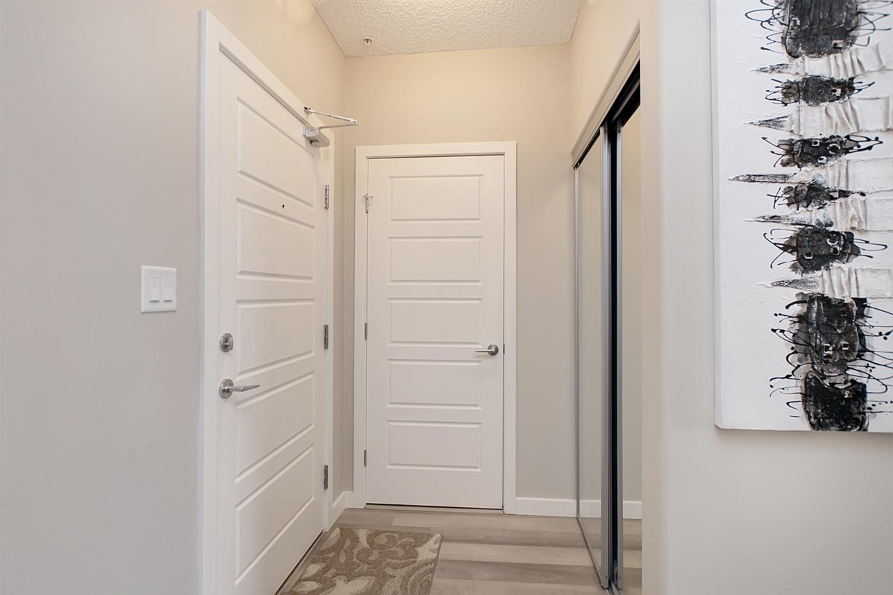 When you enter unit 319, you have a handy closet in front of you and the door directly beside the entrance is to the laundry and storage area.