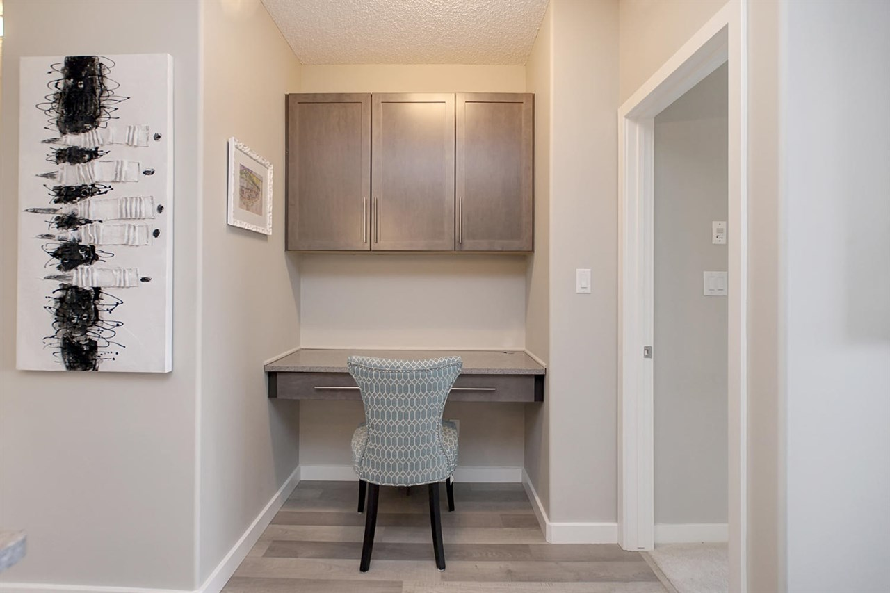Carrington knew that everybody needs a desk to keep your life organized... so the quartz counter top is here as well as throughout the kitchen and bathrooms.