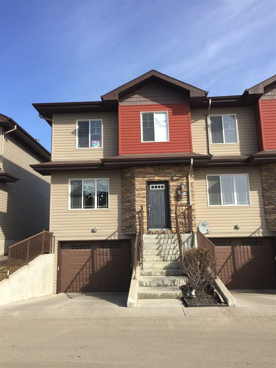 FANTASTIC LOCATION in prestigious Morello Gate, highly desirable 3 bedroom, 2 ½ bathroom QUIET END-UNIT townhome, minutes from the Anthony Henday & within a 5-minute walk to shopping, restaurants, medical services, entertainment, schools, walking trails, parks & public transportation & more. Features washer, dryer, dishwasher, stove, range hood microwave, garburator, 2 refrigerators, bright open kitchen, gas fireplace, private composite deck facing mature trees & manicured grass, large master bedroom c/w dual sink ensuite, private tandem underground parking, exceptional multi-use room, amazing storage areas, extremely low home owner fees, fantastic visitor parking, and much more. Well maintained, well managed with an extremely strong reserve fund.  Perfect for owners and investors alike.