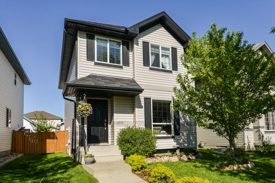 Newly upgraded w/Modern appeal in Klarvatten. This 4 bedroom, 2 storey home exudes great attn. to detail & quality finishes from top to bottom. Beautiful  hardwood flooring & oversized porcelain tiles thru-out main & upper flrs. Relax in the ambiance of the crystal glass fireplace w/floating console & surround spkr system. Gorgeous kitchen w/full height, custom soft-close cabinetry incl., buffet counter in dining area, modern concrete counters & prep. island. Patio doors allow access to a large backyard. A laundry room w/half bath completes the main floor. Ascend the hardwood curved stairs to the upper lvl to a master bedroom w/luxurious ensuite w/custom rain shower & walk-in closet. Two add'l good sized bedrooms are complimented w/full bath, tiled flr.-ceiling. The basement offers a family room, 4th bedroom and 3 pc. bath. Backyard is landscaped w/sealed concrete stamped patio, perfect for entertaining and a child's play area. Dbl. insulated garage w/plenty of attic storage. New sump pump. Must be seen!