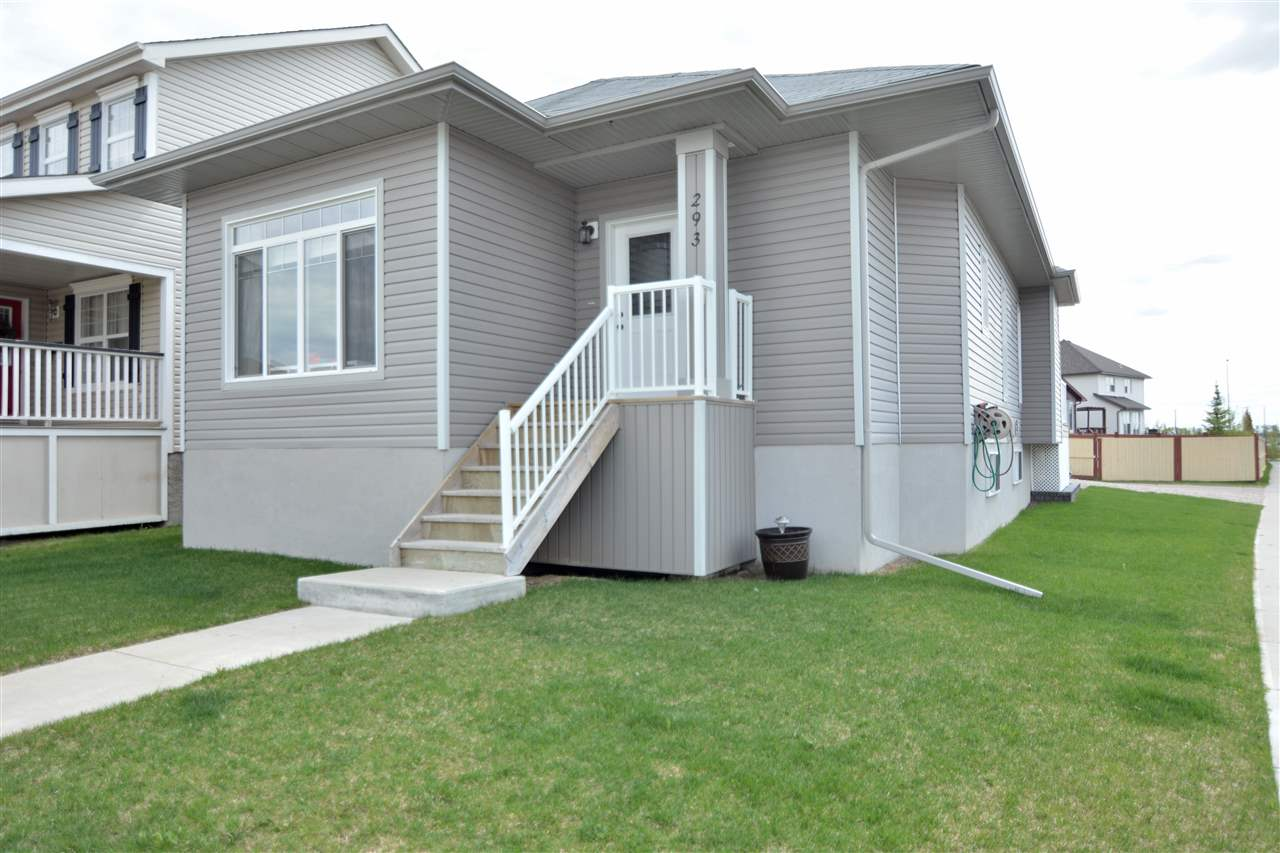Welcome to this charming bungalow located on a corner lot on a quiet street in Leduc.   Fully finished from top to bottom, with landscaping, 28'x12' back deck & a heated/insulated 24'x24' garage, this home is ready for you & your family to move into. The main floor features an open concept kitchen / living / dining room with large windows & vaulted ceilings. The kitchen has a peninsula island with plenty of space for quick breakfasts & lunches, tile backsplash, stainless steel appliances & loads of cabinet & cupboard space. The kitchen opens to the dining room with lots of space for a family table & the living room is at the front of the home.  The master bedroom is at the back of the home & features a 4 piece ensuite.  There is a 2nd bedroom, full bathroom & laundry on the main floor. The basement is fully finished with a fantastic family room with cozy stone fronted gas fireplace. There are 2 additional bedrooms as well as a full bathroom & storage space, all with LED lighting. Welcome Home.