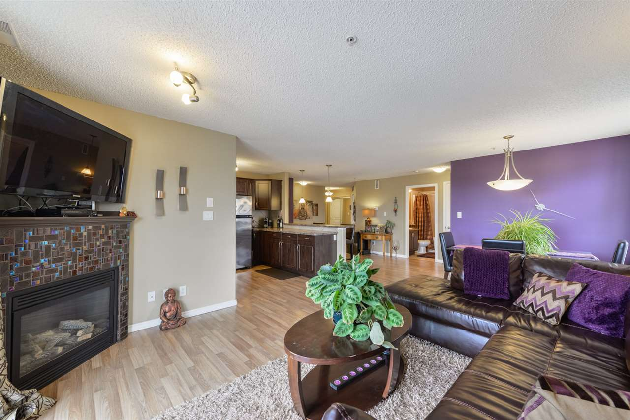 Beautiful and updated CORNER UNIT in Oxford Bay! This large 1115 sqft 2 bed 2 bath unit with HUGE WRAP AROUND BALCONY is arguabley the best floorplan in the complex. 2 Large bedrooms on opposite ends allows great privacy for guests or roommates. Open concept kitchen/living/dining area with gas fireplace is ideal for relaxing after a long day or for entertaining with friends and family. Kitchen is updated with beautiful stainless steel appliances. Enjoy your master bedroom with 4-piece ensuite! Convenient in-suite laundry and storage room near the front entrance and a heated underground parking stall with storage cage complete this amazing package! This well managed complex full of proud owners offers a fitness centre, movie theatre room, social room, and rooftop patio! Around the back of the building is a gorgeous man made lake with sitting area. This unit needs to be seen to be appreciated. Come check it out!