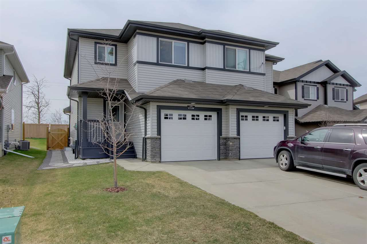 "Impeccable half duplex in popular Newcastle neighbourhood. Shows brand new!!! Original owner. No kids, pets or smoke in this immaculate home. Pride of ownership is evident through out. Move-in condition & Features include: NO CONDO FEES, functional open floor plan, gorgeous HARDWOOD floors & ceramic tile on main level, KING SIZED Master bedroom, with 3pc ensuite with oversized shower, total of 3 bedrooms. Main floor has tasteful show piece gas fireplace, stunning kitchen, with corner pantry, glass tile backsplash, tasteful décor throughout. Recent upgrades include a huge deck, complete landscaping and fencing.... all the work is done, nothing left to do but move-in and unpack. Attached Garage is insulated and dry walled and features a FLOOR DRAIN! Basement is pristine & ready to develop. All appliance are included in the sale plus an 8 X 10 shed for all your outside ""stuff"". Conveniently located close to Newcastle Centre and all the newer shops and eateries in the area, plus excellent access to Henday!"