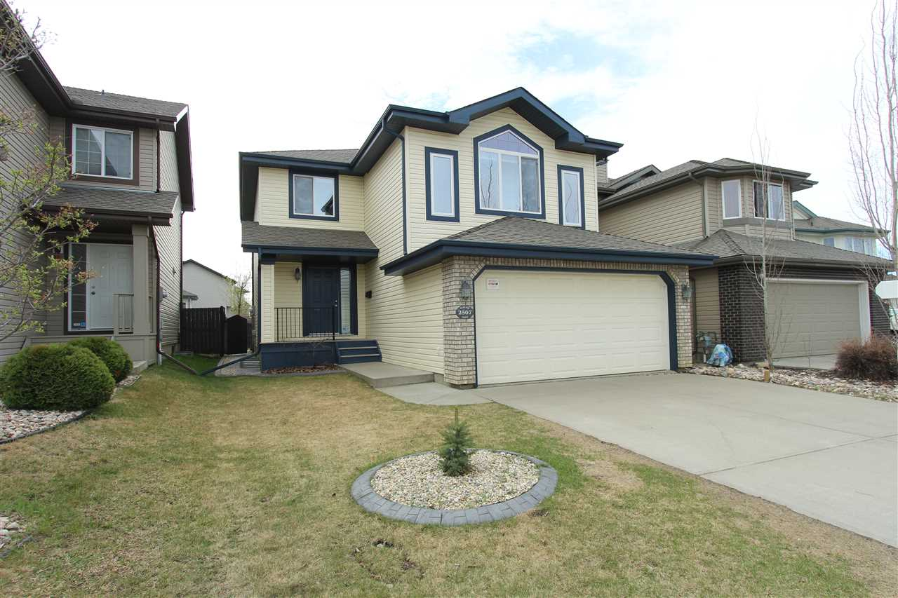 Don't miss this outstanding 2 storey tucked away in beautiful Terwillegar Greens. This completely immaculate 1800 sq.ft. home, features no maintenance porch and beautiful entry. The living room has gleaming hardwood floors and opens up to the gourmet kitchen which is equipped with a corner pantry and is connected to a large dinning room space, perfect for those special family occasions. Upstairs you will find a large master bedroom with spa like ensuite, featuring jetted jacuzzi tub and double sinks. The large bonus room with oversized windows and fire place, has vaulted ceilings and is perfect for those family movie nights. The professionally finished basement has 9ft ceilings ,2 additional bedrooms and a recreation room. The landscaped fully fenced south facing yard has a professionally built 2 tiered deck. Central air and a double attached garage make this the perfect family home! Walking distance from schools , transit and recreation centre!