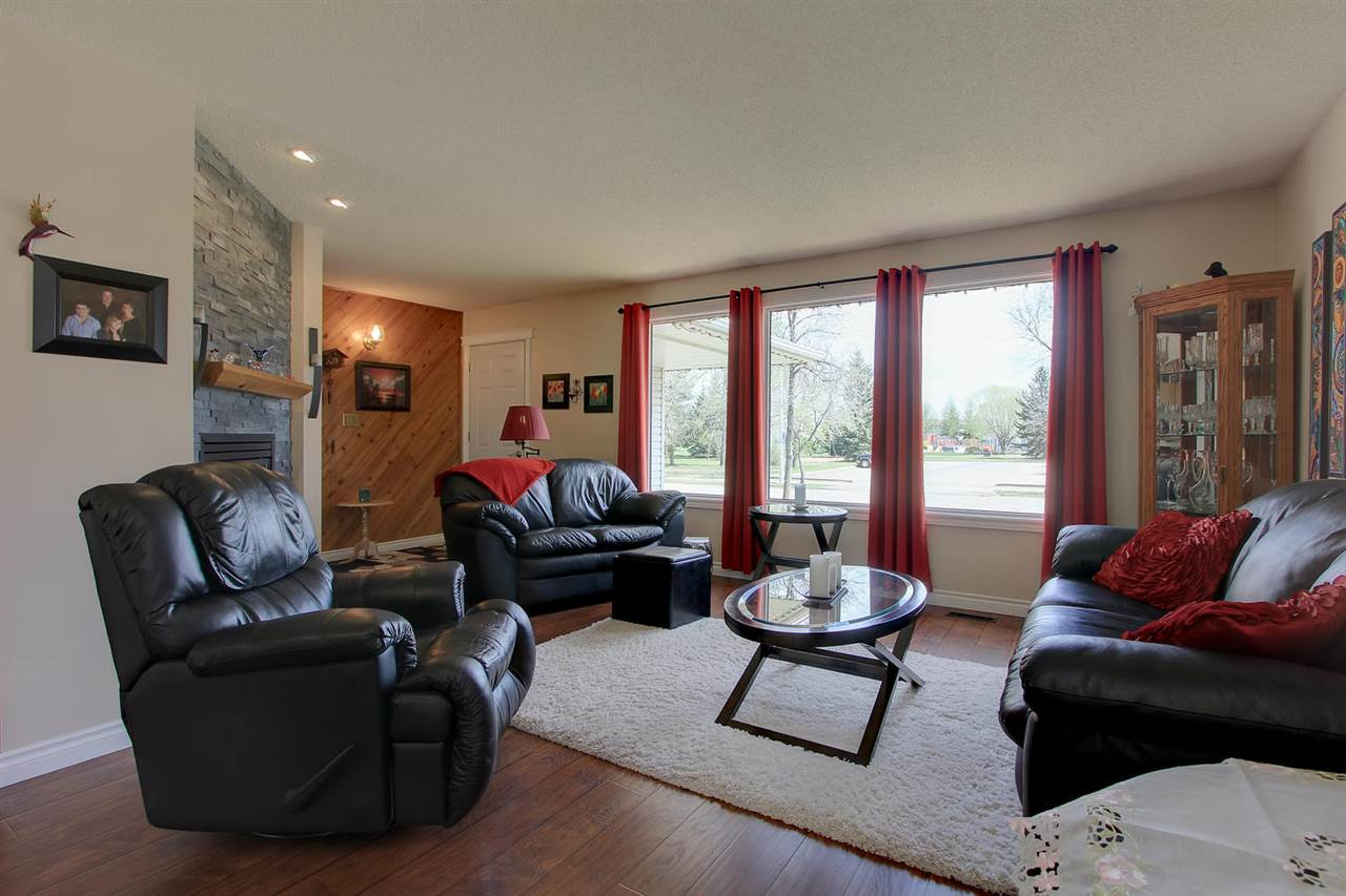 The entire main floor has hand scraped laminate flooring which makes the rooms flow from one to another. The large new windows throughout make this a sunny spot to enjoy the view of the park across the street.