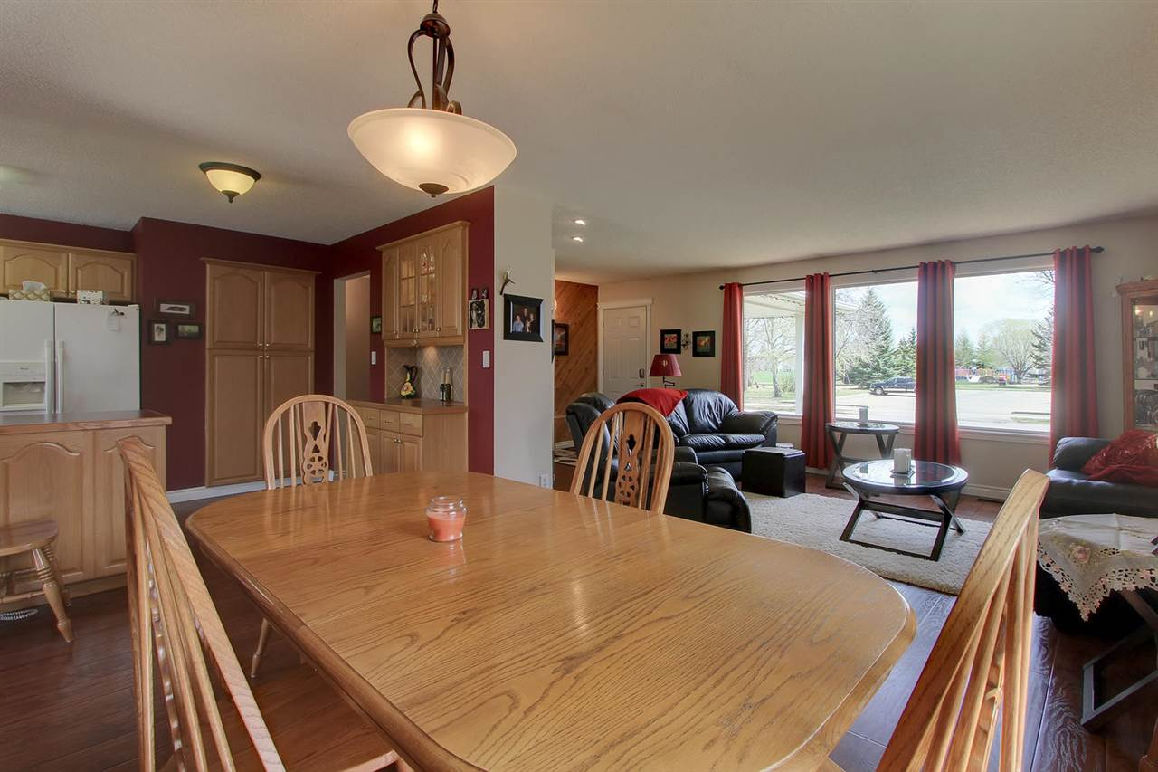 The large dining room table has no problem fitting into this large space.
