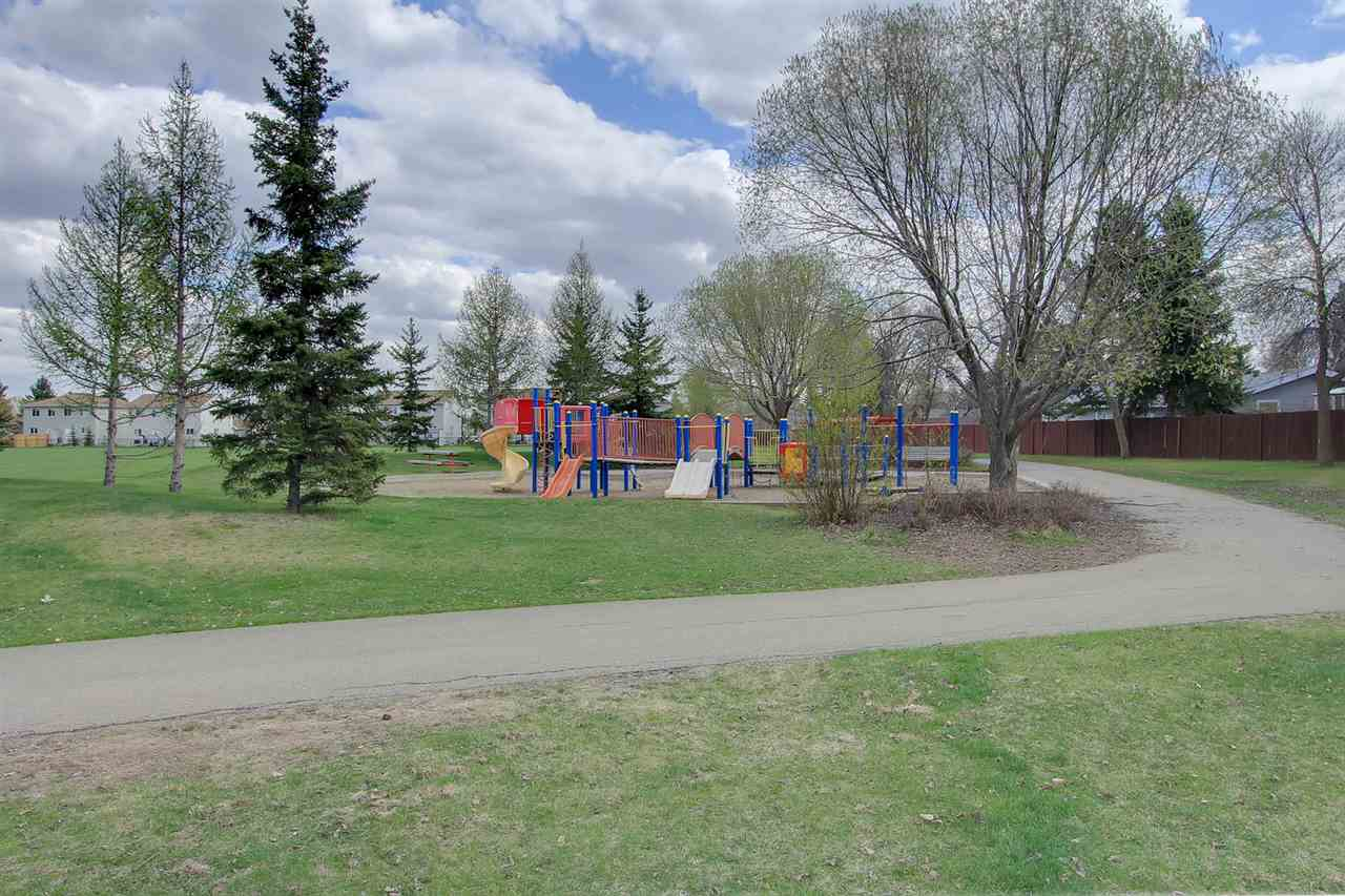 A view from the front of the house shows a nice path to walk your dog on and a playground for the kids.