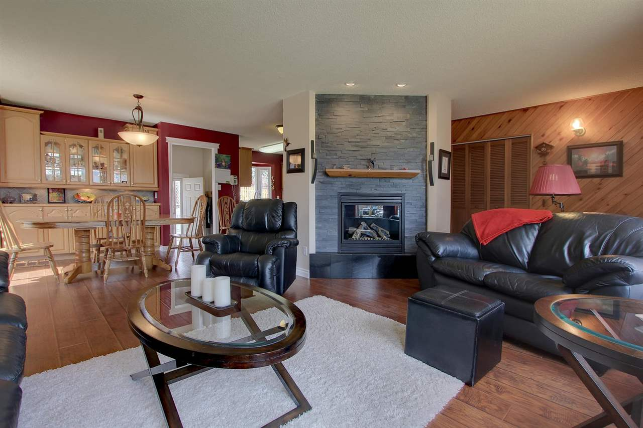 You will have great space for gatherings on the main floor with the grey stoned gas insert fireplace as a focal point. There is plenty of space from living area to dining area to kitchen area in this open floor plan.