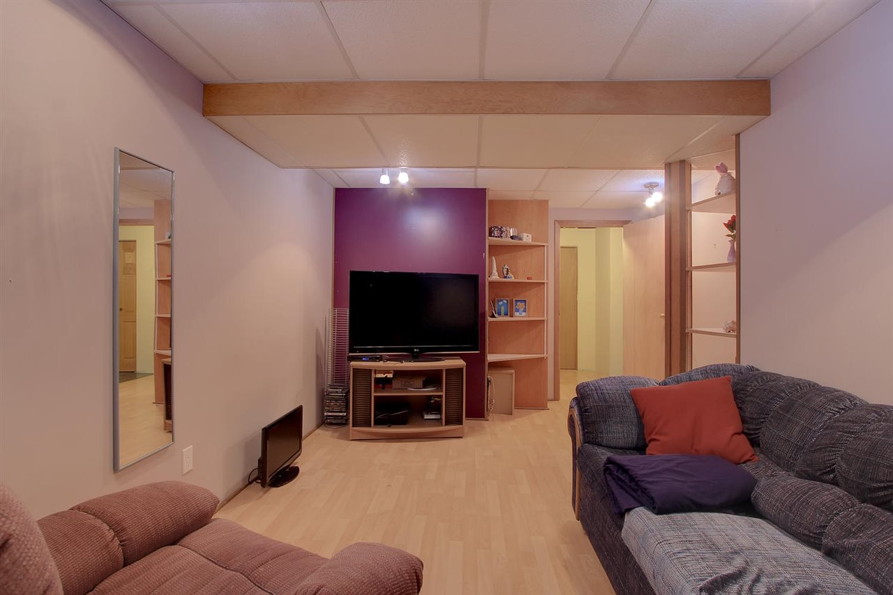 This good sized room in the basement would make an awesome media room. There is no window, handy laminate flooring and the space would easily fit a few media room seats.