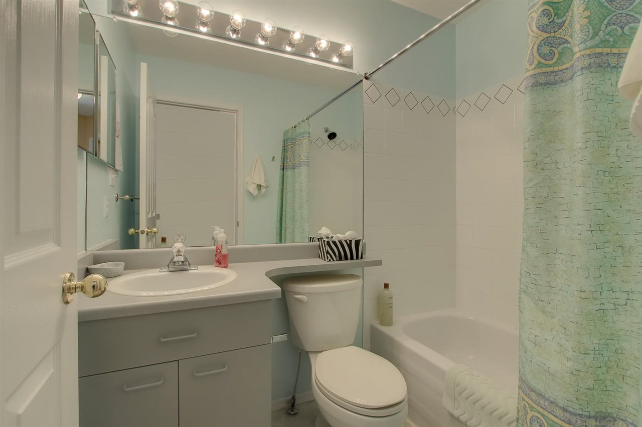 The main bathroom has a full bath tub also.