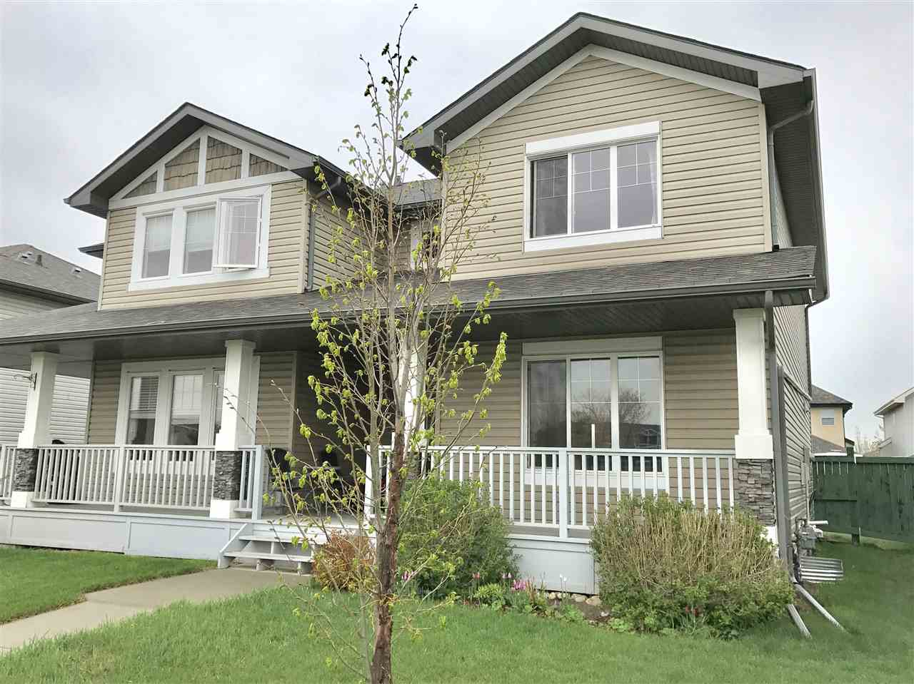 NO CONDO FEES HERE! Step up onto your front verandah and enter into the foyer of this spacious fully finished home. The front living room has a cozy corner gas fireplace and large bright west facing window. The kitchen/dining room features a large island with raised eating bar, corner pantry and French door to the back deck. The main floor 2 pc bath completes this level. Upstairs you will find the huge master suite with full ensuite and walk in closet, Two other good sized bedrooms, laundry and main bathroom. The basement has been professionally finished with rec room, bedroom, storage room and a spa like bath with double tile surround shower. The yard is fenced and has a concrete pad for your future double garage. There is a park across the street as well as walking trails, public transportation, schools, shopping all within walking distance. This home is in a great family community and will not last long so check it out today!