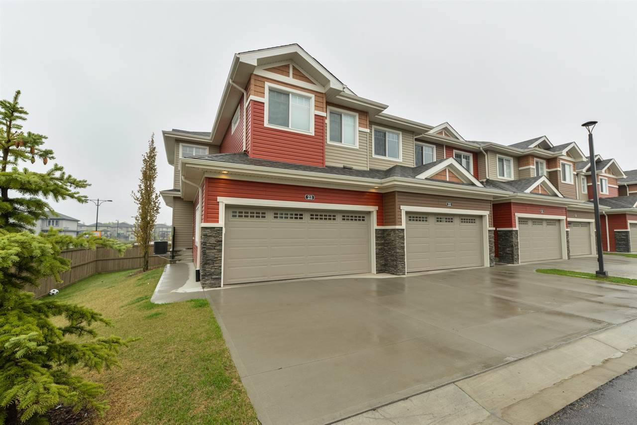 Low Maintenance Living in this Fantastic End Unit! Over $14,000 in upgrades, this home with a Double Attached Garage is sure to please. The main floor has your gorgeous kitchen with granite countertops, under mount sink, gas stove, fridge with water line & upgraded hood fan.  The dining area overlooks your deck that has a gas line for a BBQ & the Living Room features an electric fireplace. Plus there is a 2 piece bathroom & access to your double attached garage. Upstairs is your large master bedroom that has a great walk-in closet & ensuite, 2 additional bedrooms, another bathroom & laundry! The basement is unfinished but has rough-in plumbing for a future bathroom & awaits your personal touch.  Additional Upgrades include Air Conditioning, additional windows throughout, rough-in vacuum system, rough-in garburator, countertops, carpets, banister, baseboards & doors. Easy access to the Anthony Henday, Whitemud, Shopping Schools & more! This is a must see!