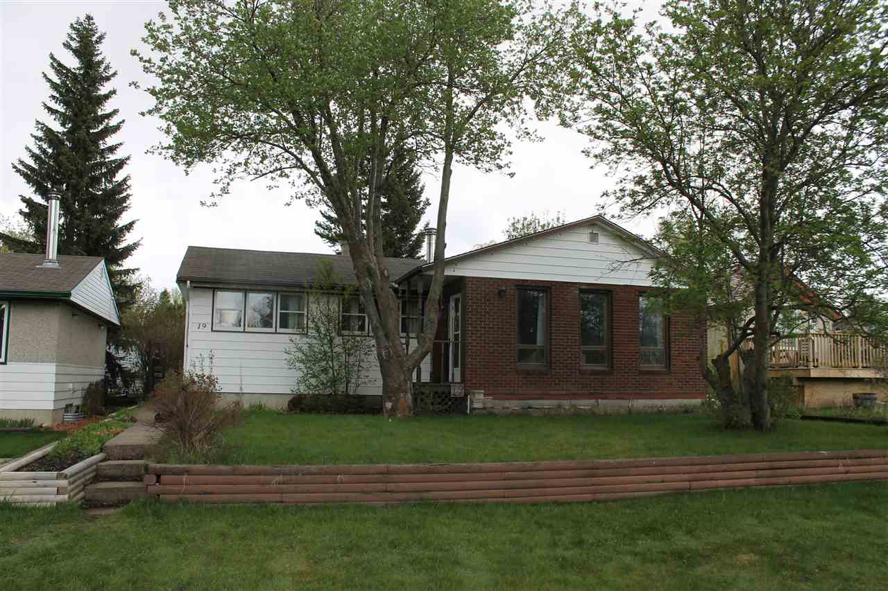 Located on Main Street in Ardrossan, this one owner 1149 Sq Ft 3 bedroom bungalow also has a 20x22 double detached garage .  This great home features a huge living room with wood Burning fireplace, dining area overlooking back yard, kitchen with some renovations, 3 good sized bedrooms, and a redone main bath.  Developed basement with a large recreation room (TIKI-themed), bedroom, roughed-in bathroom, laundry and furnace room.  Home has been well maintained but shows a little age.  Cozy yard features a Gazebo, Pergola, rear drive garage and trailer storage.  Located across from the Hall, post office, fire hall and walking distance to the Ardrossan Rec Center, and the local schools.
