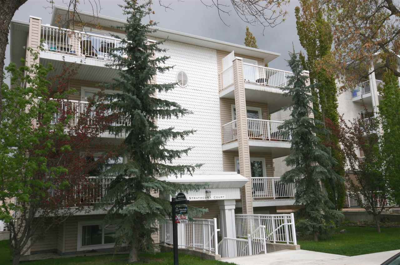 FANTASTIC LOCATION, Welcome to the top floor of Strathcona Court. Wonderful views form the south facing wrap around balcony. Only a few blocks off Whyte Ave, across from a park and in close proximity to the U of A and Hospital. Open concept layout anchored by comforting corner fireplace, the kitchen offers a nice window above sink and flush island bar. Master bedroom with 4 piece ensuite and two closets, one of which is a walk-in. Second bedroom is a good size with a full bath right outside in hallway. Washer/dryer located in laundry closet, ample storage throughout the home. Natural gas barbecue line and BBQ on balcony, newer hot water tank, assigned parking around the back, elevator and a very well managed building. This home is a beauty.