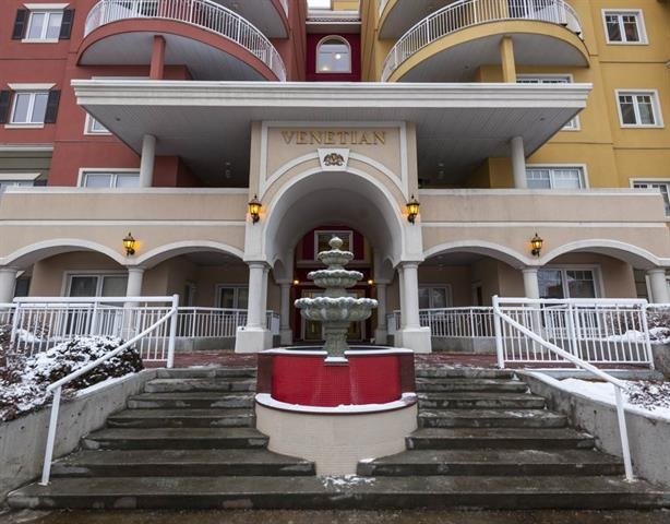 Welcome to this sun filled concrete and steel condominium in The Venetian. This fifth floor, 2 bedroom, 2 bath plus Den home features; spacious open floor plan, kitchen with island, ceramic floors in kitchen and bathrooms, laminate flooring in living and dining room, carpet in den and spacious bedrooms, full 4 piece main bath and 3 piece en suite, plenty of west view windows, large west balcony with gas line and 2 titled side by side heated, secured underground stalls with easy access to elevator complete this unbeatable home. Enjoy the main floor fitness room and the prime location with the new Ice District minutes away and handy access to l restaurants, shops and cafes. The Business/Financial Hub, Theater, Arts, Fitness, Shopping, Transportation, River Valley are all within minutes and Macewan University is right across the street. This spacious, sunny home is packed full of value and ambiance.