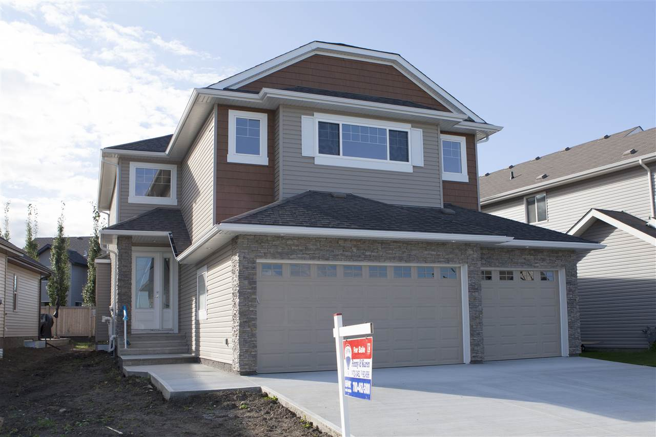 Welcome to this great family home. Almost 2500 sqft of completed living space with a full basement not developed yet. 3 bedrooms upstairs and a den on the main level, 3 bathrooms including a 3 pc on the main floor. Tile & hardwood throughout the main floor, large kitchen with a walk through pantry. All stainless steel appliances included, fridge, gas stove top, built in oven, built in microwave, built in dishwasher, range hood, washer & dryer. Back entry to garage has a walk in closet. Upstairs you will find 3 good sized bedroom, main 4 pc bath, large bonus room & laundry room. Great location, in walking distance to schools and even a triple garage for Dad !
