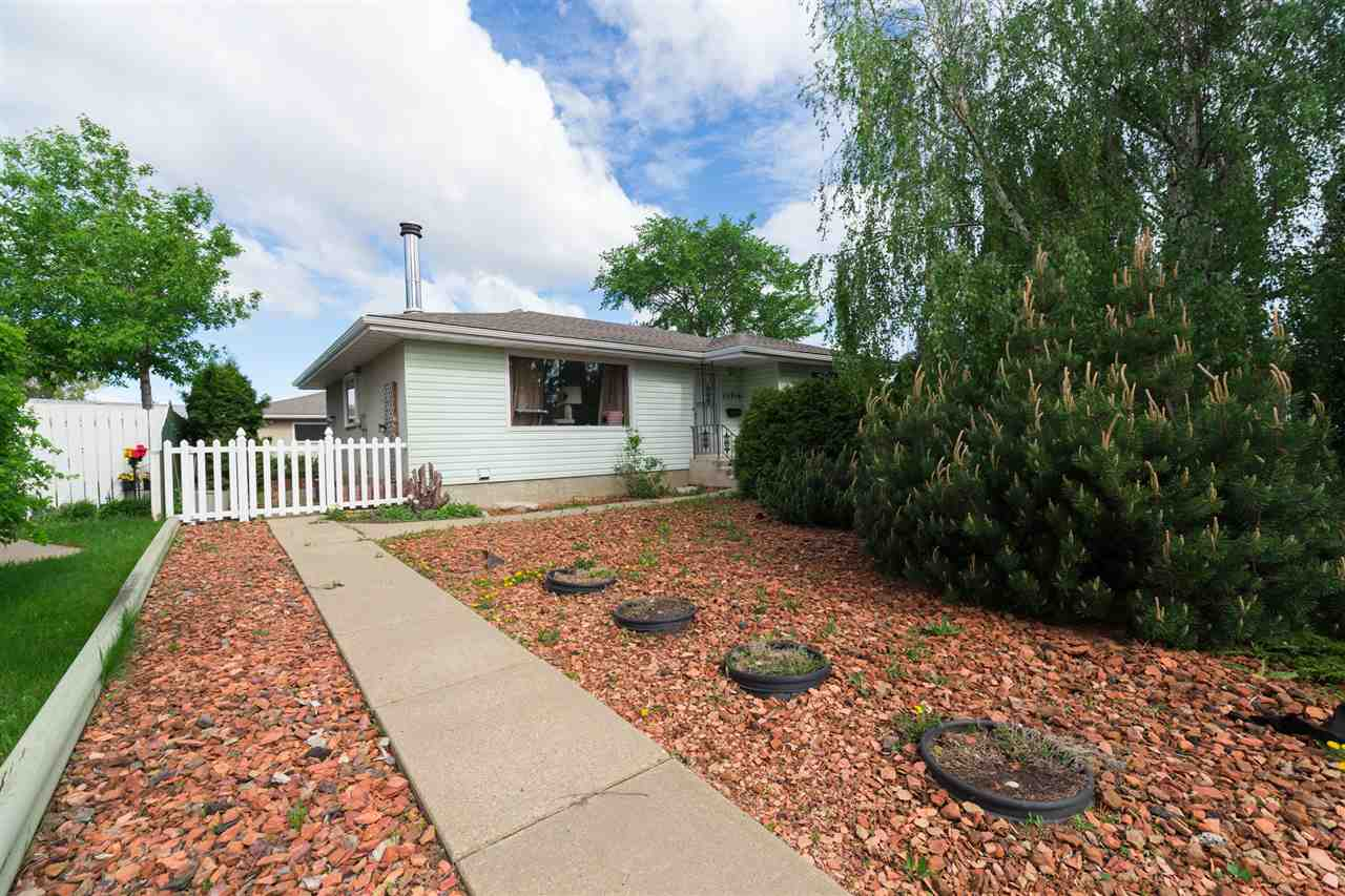 Wow!! Nearly a 1/4 of an acre in the city!! Grow all of your own veggies. This fully finished Kilkenny bungalow is located on a mature street with lots of trees surrounded by well kept homes. New shingles on the house and garage and all of the windows except for the front window have been replaced. The main floor has 3 good sized bedrooms, a full 4 pc bathroom and a 2 pc ensuite. The front living room is flooded with natural light, a large dining room and a bright kitchen round out the main. The separate side entrance offers suite potential. Once downstairs you'll find a workshop area, a huge laundry area complete with loads of cupboards and a double sink, a 4th bedroom, 3 piece bathroom and a very cozy family room anchored by a wood burning fireplace. And last but certainly not least, the massive yard and impressive 22x30 heated garage and shop, which could be converted to a triple garage. Close to all level's of school and public transportation.