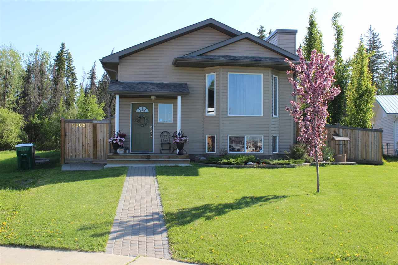 This Beautiful 1250Sqft Bi-level Has great curb appeal. There is so much natural light in this house due to all the windows. The living room is spacious with a gas fireplace. There is plenty of room in the kitchen with tons of cupboards as well as a pantry and an island to do all your prep work and baking! The formal dining room use to be a third bedroom and can easily be converted back into a bedroom if it is needed. The master bedroom is very large and has a big walk in closet. The ensuite is your own private oasis.The main floor is comlpete with a four piece bath and a second bedroom. Downstairs was professionally done which includes a very large rec room with a bar, two very bright bedrooms, a bathroom with a big shower and then the Laundry/utility room. Outside is an enormous back yard with RV parking  a 24'x26' Double heated garage. There is also a 28'x14' Deck on the side of the house. There is a treed nature reserved land behind the property so there will never be anyone behind you.