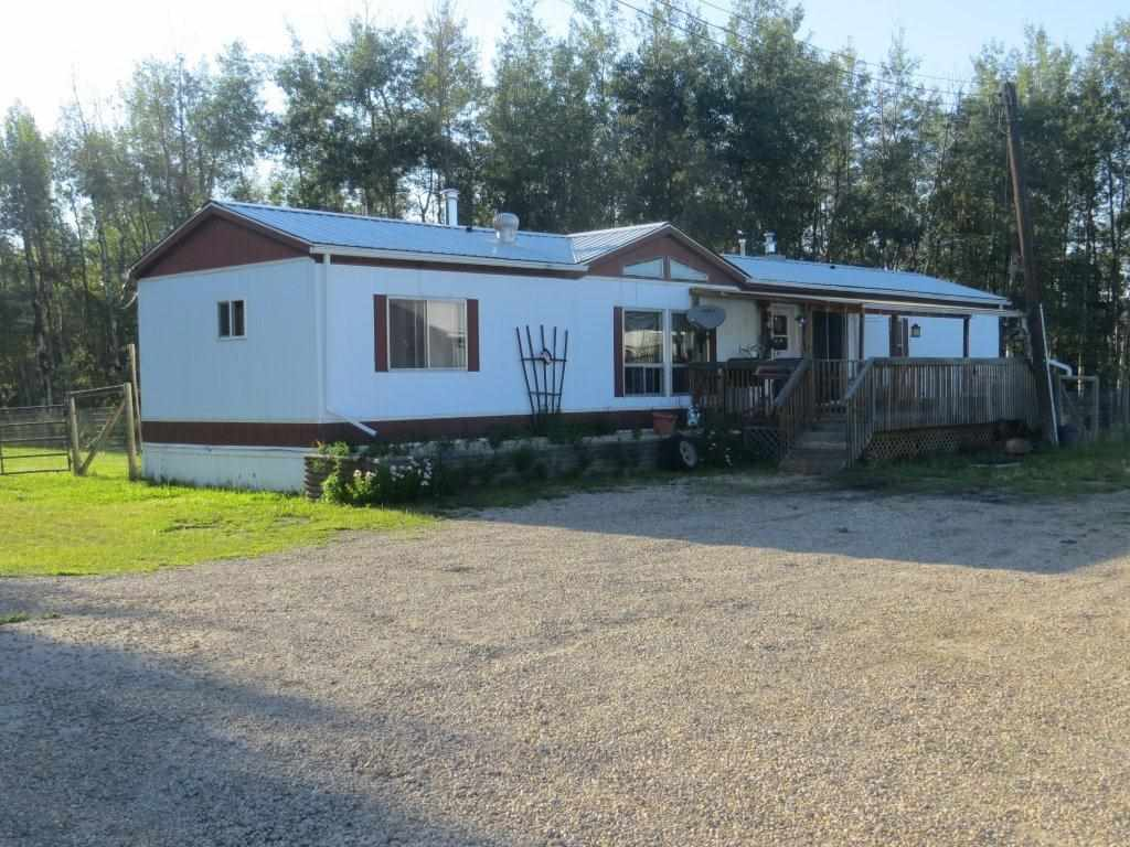 Mayerthorpe- 2.27 acres w/ 1985- 16' X 72' modular/ 12 X 20 front covered deck, 12 X 24 rear deck, kitchen & dining area, large front room, 2 bedrooms, 2 bathrooms, fenced yard. 38' X 52' shop w/ 16' high door, insulated & lined, furnace,, attractive yard site, access from pavement. Close to curling,  hockey arena & shopping downtown.