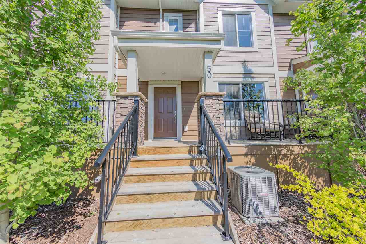This gorgeous townhouse is in one of Edmonton's most desirable Communities, the Estates of Upper Windermere. This home offers an open concept main floor with a large living room, a 2-piece bathroom, a large kitchen featuring stainless steel appliances, quartz counters, and island as well as a dining room with access to a large over-sized balcony that has a gas line for a BBQ. The upper level consists of a large master bedroom with a full ensuite and WIC, two more bedrooms and 3-piece bath. Conveniently located you will also find the upstairs laundry room which features a top load washer & dryer. The basement is fully finished with a family room and 2-piece bath. Double attached garage is fully finished and with snap on storage unit included. Located minutes from the Anthony Henday, and is within walking distance to Superstore, Starbucks, and other amenities. Close to the Currents of Windermere, churches, schools, public transportation, with a park right outside your door You don't want to miss this one!