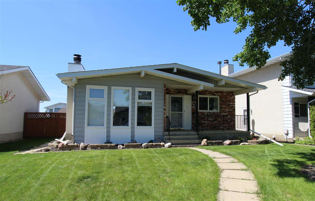 What an opportunity for ownership with this 1,200 sq. ft. bungalow! This perfect family home features 4 bedrooms and 2.5 bathrooms! The main floor boasts fresh paint, renovated two-tone kitchen with tile backsplash and new countertops, separate dinette area and spacious living room. The master suite has patio doors leading to the rear yard and a two piece ensuite. The fully finished basement features plush carpet, wood burning stove, fourth bedroom, full bathroom and a massive storage area. This home is complete with a fully fenced and landscaped yard, gas line for BBQ, oversized garage (23x23) with heater and wall mounted TV. Upgrades include newer windows and roof, new high efficient furnace and water heater, upgraded light fixtures and a front-load laundry pair. This move-in ready home is waiting for your family!