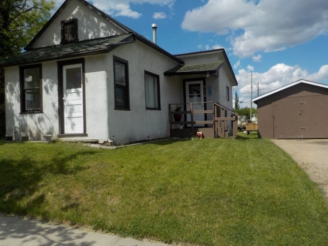 """PERFECT FOR A SINGLE PERSON...COZY & COMFORTABLE & AFFORDABLE...1 bedroom with walkin closet, updated kitchen & living room, 4 piece bathroom, veranda...fully fenced 50x150 lot...single detached garage 14'x24' & 8x12 garden shed. OR """"REDEVELOP BY BUILDING NEW"""""""