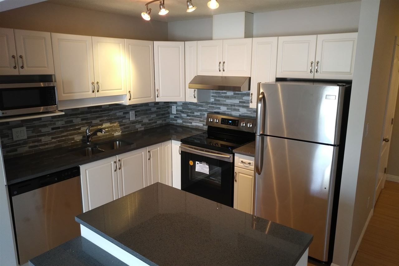 Upgraded kitchen & bathrooms, 2 bedroom & 2 full bathrooms, centrally located just off Whyte Ave, Farmers Market, River Valley, fantastic local shopping, transportation, U of A, and entertainment. Third floor suite, well maintained 18+ building, bright open plan, in suite laundry & storage w/additional storage locker & bike shed, covered parking stall/ plug-in. Island kitchen with new appliances, dining area with patio doors to deck, cozy living room fireplace, master bedroom with 4 piece ensuite & walk-in closet w/organizer. Security entrance, elevator, condo fee includes utilities except electric, very desirable area located within walking distance to amenities.