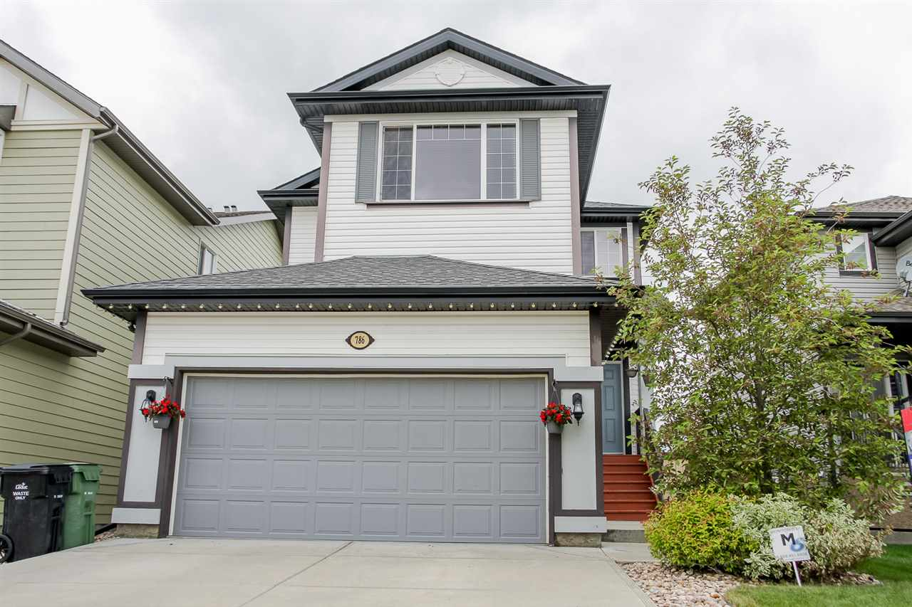Warm & inviting, this 1951 sq ft, 4 bedroom, 2.5 bath 2 storey in popular Southfork is calling you home! From the lovely front entrance, to the fenced and landscaped back yard with oversized deck, every part of this home will make you want to move in today! The main floor is open concept with lovely neutral paint colours and trim. The living room has a gorgeous gas fireplace with exquisite mantle & tile surround. The warm hardwood & kitchen cabinets with spacious island are sure to delight! There is a ton of natural light from the large windows & glass doors leading out onto the spacious back deck. Relax on the second floor with a generous sized bonus room, just a few steps up to the bedrooms. The master suite has an inviting 4 pc ensuite including a tile surround soaker tub & stand up shower. Two more bedrooms & second 4pc bath complete the upper floor. The basement is 60% finished, including framing, drywall, electrical and one bedroom complete. Finished up with spacious garage with awesome workbench!