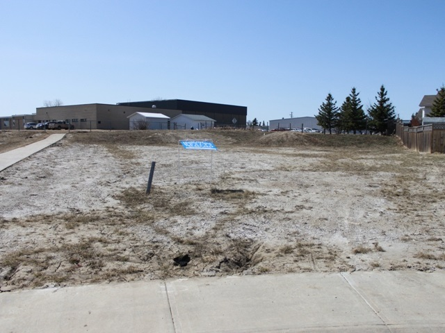 This is a great lot to build your dream home on, in Tofield just 30 minutes east of Edmonton and Sherwood Park and 45 minutes from the Edmonton International Airport (YEG).  Located in newer subdivision beside the school grounds and adjacent to the walking trail.  Large pie shaped lot with back yard access off of avenue.  Tofield offers a health centre, medical clinic, pharmacies, 2 schools and numerous recreational opportunities.  Welcome home!