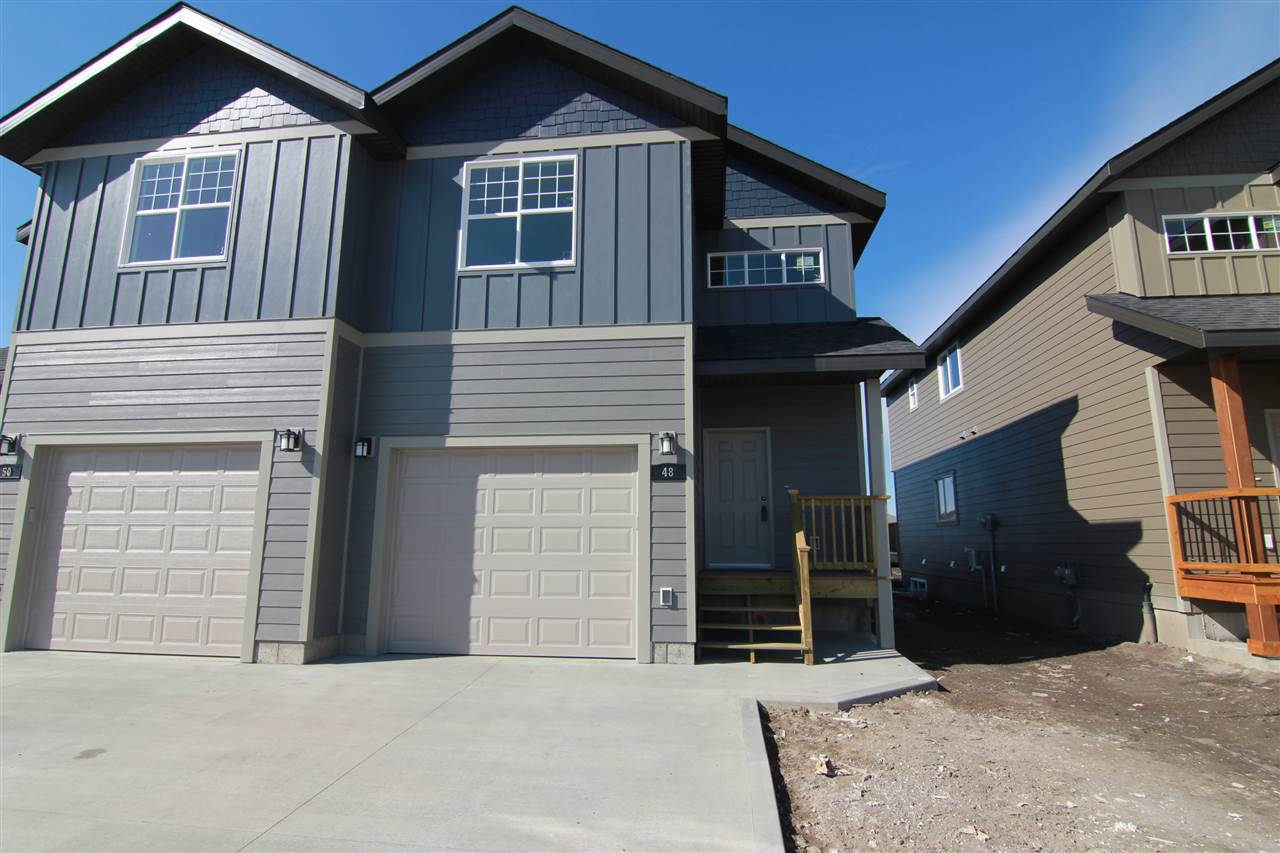 Discover this 1705sqft BRAND NEW half duplex. Loaded with high end finishing through out! The main floor has a spacious TWO STOREY entry, GOURMET KITCHEN with an abundance of cupboards and counter top space, tile backsplash, GRANITE counter tops, pots and pan drawers, and eating bar. There is a large dining area with access to a private DECK. The great room is OPEN CONCEPT and filled with natural light and features a gas fireplace with tile surround and custom mantle. Completing the main floor is a half bath, access to garage and HUGE MAIN FLOOR LAUNDRY ROOM! Upstairs there are 3 spacious bedrooms and main 4pce bath with GRANITE counters. The master bedroom is pure luxury with DOUBLE DOORS, VAULTED CEILINGS, walk in closet and 4pce ENSUITE with GRANITE COUNTERS. 6 APPLIANCES INCLUDED, HARDWOOD through out the main floor and premium HARDYBAORD SIDING with 30 year warranty. Fantastic location just steps to the tri leisure centre, parks, schools and all amenities.