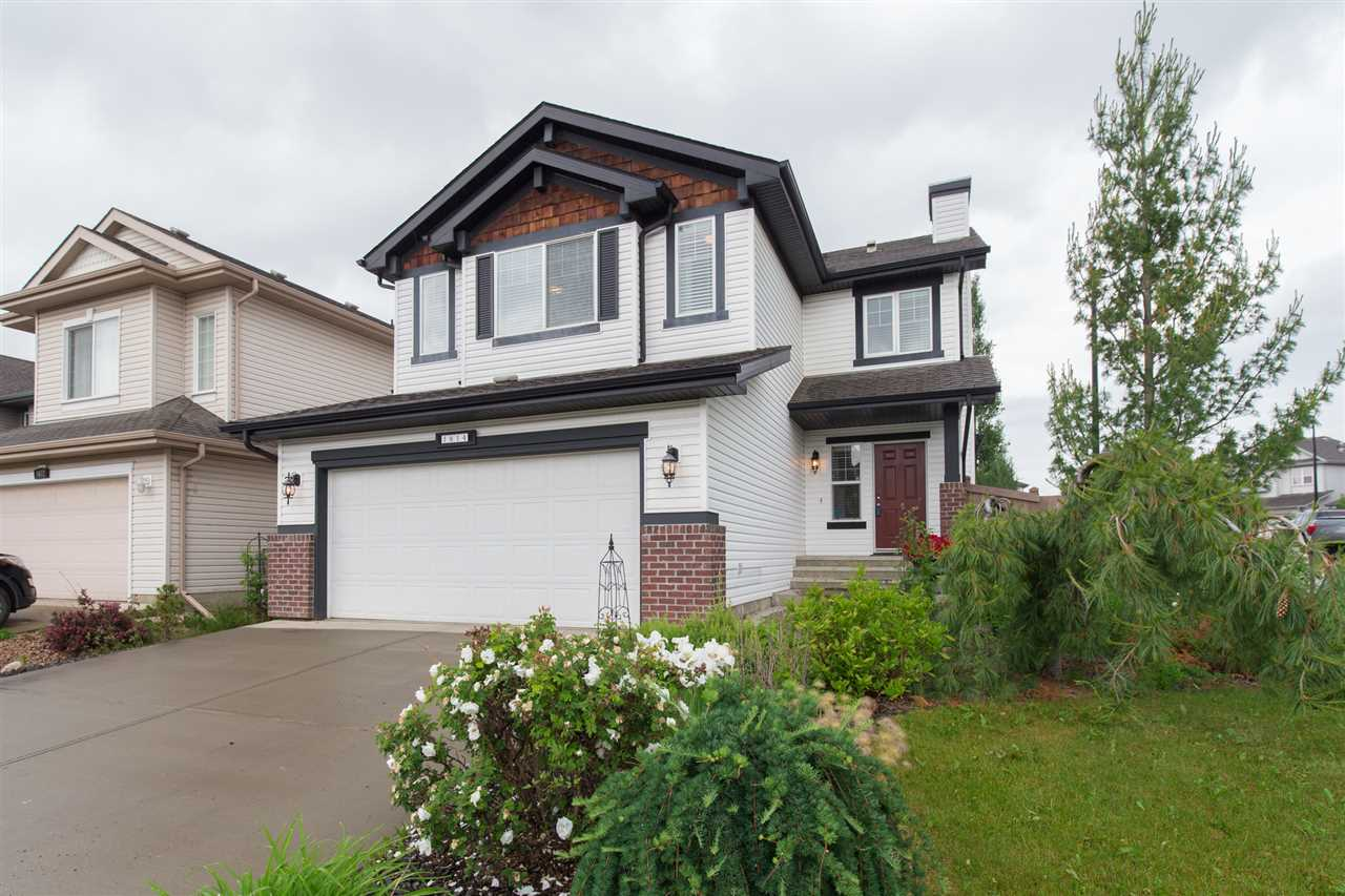This fantastic 2-storey, 1953 sq ft, 4 bedrooms, 2.5 bathrooms family home is located in a quiet cul-de-sac in the desirable neighborhood of Hodgson. The main level features a spacious living room with corner gas fireplace, a functional kitchen with huge island, a walk-in pantry, ceiling height cabinetry and stainless steel appliances. Dining area boasts huge bay windows that let in plenty of natural light. A 2pc bathroom and a laundry room complete this level. Upstairs features a fabulous master bedroom with full ensuite and walk-in closet, 3 additional bedrooms and a 4pc bathroom. Freshly painted throughout and new hardwood floor in all 4 bedrooms. The clean and unspoiled basement is ready for your personal touch. Fully fenced and landscaped backyard with a large deck. Great location, steps to Hodgson park, Whitemud Creek ravine, Terwillegar Rec Center, public transit and shopping centers.