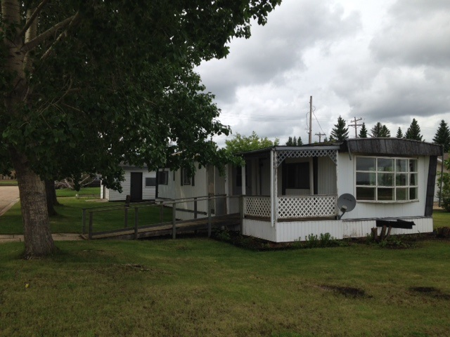 Affordable, 3 bedroom, 1&1/2 bathroom, wheelchair accessible home on owned, double sized lot in Viking. Ideal, corner lot is close to school, hospital, clinic and new drugstore. Has had some upgrades but could use more TLC. The single detached garage has front access and the covered porch and garden shed are an added bonus.
