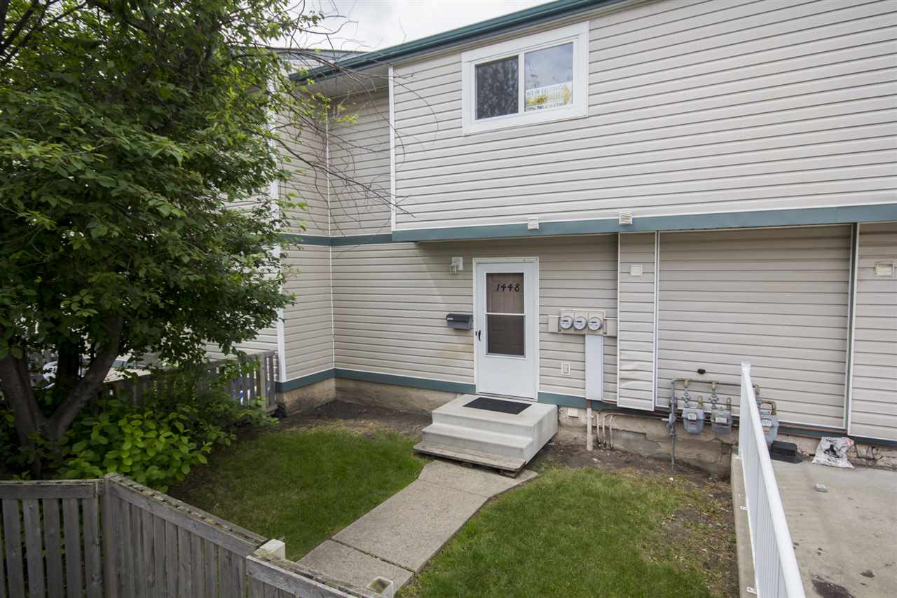ATTN: Investors and first-time home buyers! Lovely TOP FLOOR 3 bedroom townhome with 2 parking stalls on Edmonton's southside. This 1011 sq. ft. 3 bedroom, 1 bath townhome in Laurentian Estates offers ENSUITE LAUNDRY, laminate & carpet flooring throughout, upgraded counter-tops (and a new tap!) in the kitchen, tons of storage space and more! Main floor is spacious and functional with large entry, front closet, main floor laundry, kitchen, dining room, storage room, and large living space. Upstairs, 3 bedrooms and a full bath. There's even a separate storage room upstairs! Large fenced yard with a mature tree for added privacy. Unit comes with 1 covered stall and 1 stall directly behind it (tandem parking stall for 2 cars) located directly beside the stairs to go up to the unit. NEW WINDOWS throughout building! Walk out your door to public transit... located close to COSTCO, South Edmonton Common & all amenities!