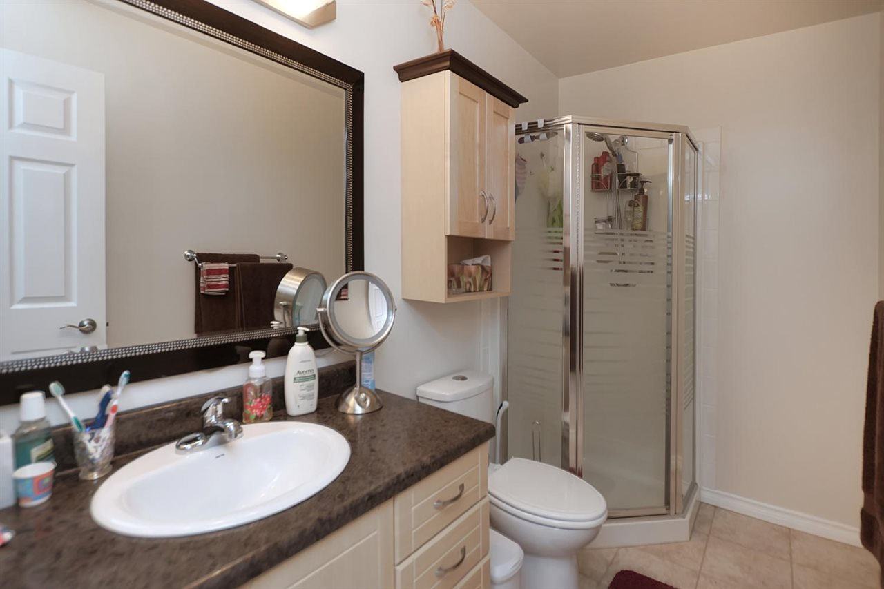 The master bathroom has a handy neo angle shower, new vanity, counter top, porceline  sink, taps and toilet.