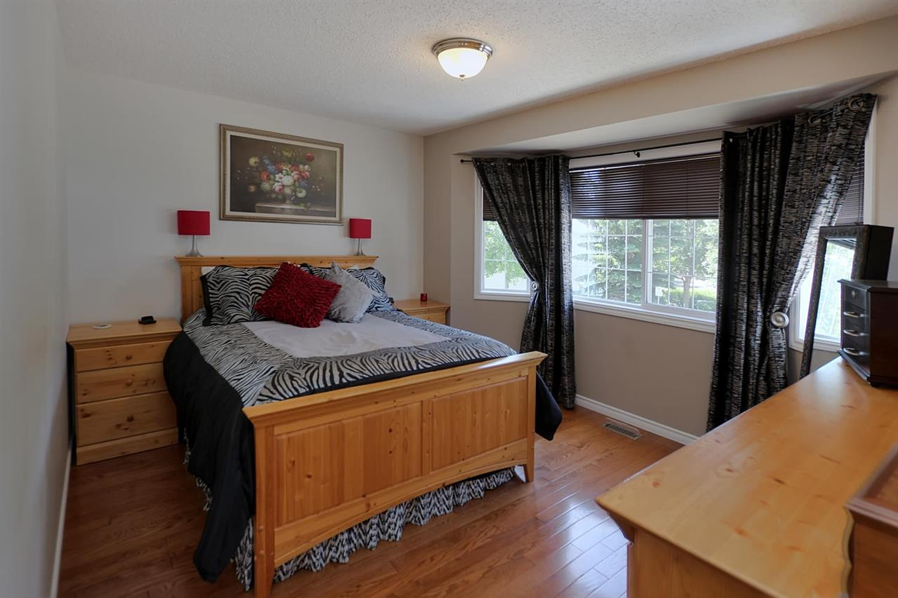 This Master bedroom is spacious and the upper bedrooms and hallway are real hardwood. The bay window fills the room with light. There is also an en suite bathroom, large walk in closet and space for a dressing table.