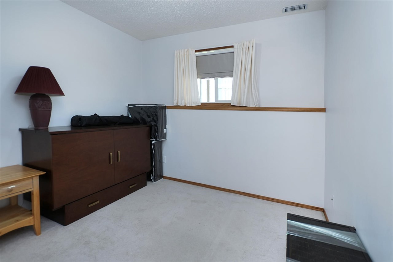 The third bedroom is on the lower level. It has the only carpet in the unit. A large window, wide cupboard and location next to the 3 piece bathroom make this a perfect spot for a teen or as a guest area.