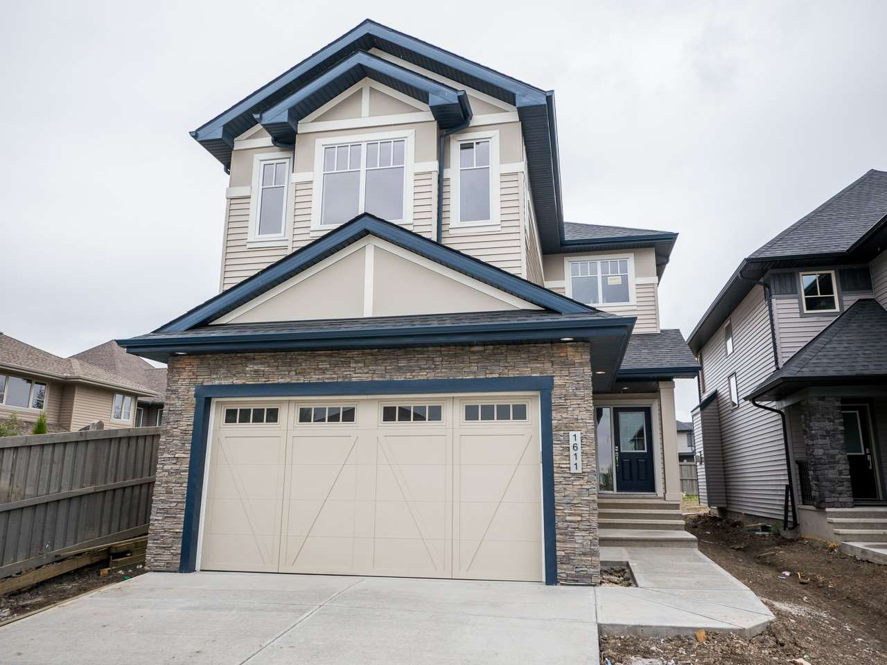 Brand new 1966 SQFT 2-Storey located in Ambleside. Perfectly located home is walking distance to Windermere Mall and bus stop. Only one block from playground. Beautiful house comes with high ceiling at the main entrance. Main floor with living room, kitchen, dinning and half bath. Custom Kitchen has with walk-through pantry. Glossy kitchen with Quartz counter tops. Set of stainless steel appliances with gas cooktop. Upgraded finishing with maple railing. Flooring comes with 12x24 tiles, Engineered hardwood and carpet. Upgraded plumbing fixtures. Huge size lot. 9ft basement. Rear deck with vinyl flooring and metal railing. Builder will finish the front landscaping. Exterior stone work. Much more..
