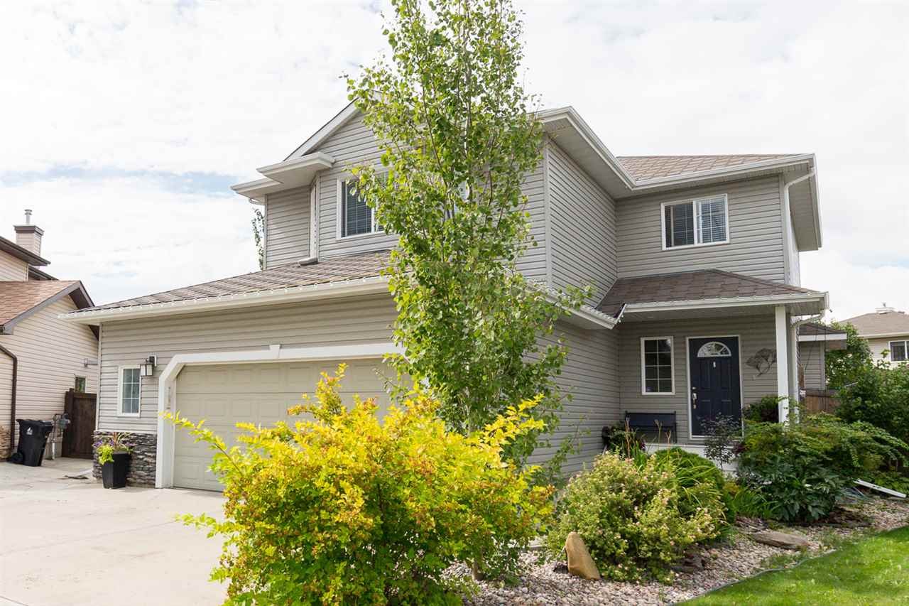 2006 Custom Homexx 1920 sqft 2 Storey in Legacy Park. The Inviting large front entry is open to the main floor w/a spacious great room, large kitchen w/maple cabinets and eating breakfast bar with hardwood and ceramic tile. The main floor is completed with a 1/2 bath, laundry and garage to house entry. The upper floor features 3 spacious bedrooms and a large bonus room w/barn door and electric fireplace. Master bedroom features a walk-in closet and a 4 piece ensuite. There is a family room, play room, a 4th bedroom and a 4 piece bath in the recently developed basement. The kitchen garden door leads to the 16x35 pressure treated wood deck and oversized southwest facing pie lot w/mature trees, vegetable garden. The fenced and private yard features a side gate with access to a parking pad. Double oversized attached garage. A completed move in ready property! New K-9 School Cooperhaven to be ready Fall 2018.
