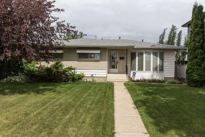 This 3 bedroom  bungalow features an upgraded kitchen with a ton of cabinets and counter space.  The bedrooms are generous in size with large closets.  The home has a fully developed basement with an additional bedroom, 3pc bath nice family room area and a huge cold storage room.  The yard is a good size and well landscaped.  There is a full double detached garage.  The home is located close to 2 schools so ideal for a young family.  The roof ,furnace and the hot water tank are newer.