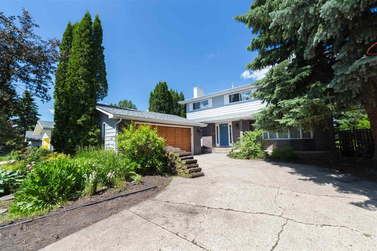 Located in highly desirable Aspen Gardens. This recently painted 2,338 sq ft Perry built two storey has a lot to be proud of. Highlights include: a massive 975 m2 lot, 2 high efficiency furnaces, newer hot water tank, new humidifier and a double detached oversized garage. The completely renovated kitchen boasting compressed composite countertops, gas range with down draft and on-trend ceiling height white cabinetry offering a ton of storage. There is a large dining area, formal living room and a cozy gas fireplace anchoring the large family room. The main floor also boasts a huge mud/laundry room with a separate side entrance and a large 2 piece powder room. Upstairs you'll be impressed with an enormous 5 pc bathroom and 4 bedrooms, including a master with a spacious 3 pc ensuite and 2 closets (walk-in and walk-thru). The basement is tastefully finished with a rec room, bedroom and a huge storage room. The massive backyard is fully fenced with a deck and BBQ gas line.