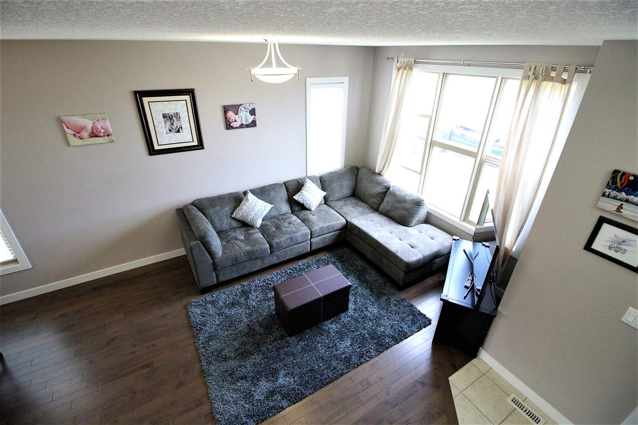 END UNIT! Absolutely stunning home in Spruce Grove's prestigious Greenbury! With over 1,300 square feet of living space above grade plus the fully finished basement this property is ready for you and your family to call it home! This fully finished home features a beautiful open concept main floor with a spacious dinette area, 4 bedrooms, 3.5 bathrooms including your 4 piece master en-suite, hardwood flooring, quartz countertops, landscaped backyard and so much more! Fronting a park that leads to the amazing Jubilee Park! This home is also minutes to the new Prescott Learning Center, the up and coming spray park and the soon to come Beaverbrook Wellness Center. This well cared for home is demanding action! Come investigate today!