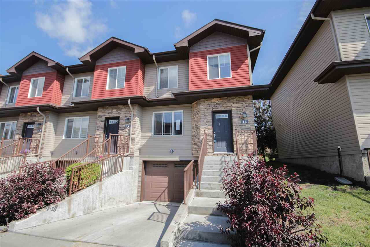 """Fantastic 2 storey, end unit townhouse in Morello Gate! This well kept unit features a nice size floor plan with over 1300 sq ft of living space. Main floor features a large living room with gas fireplace, good size eat-in kitchen with access to your private, rear deck for your barbecue. Upstairs you will find 3 bedrooms including a master with 4 piece ensuite. Finishing off the upper level is another 4 piece bath and laundry closet. The garage is also a tandem garage with additional storage space, large enough for 2 vehicles. End unit makes this townhome feel very private as well.  Close to all amenities and public transportation right outside your front door. Walking distance to anything you would need! Schedule """"A"""" must accompany all offers, property sold """"as is, where is""""."""