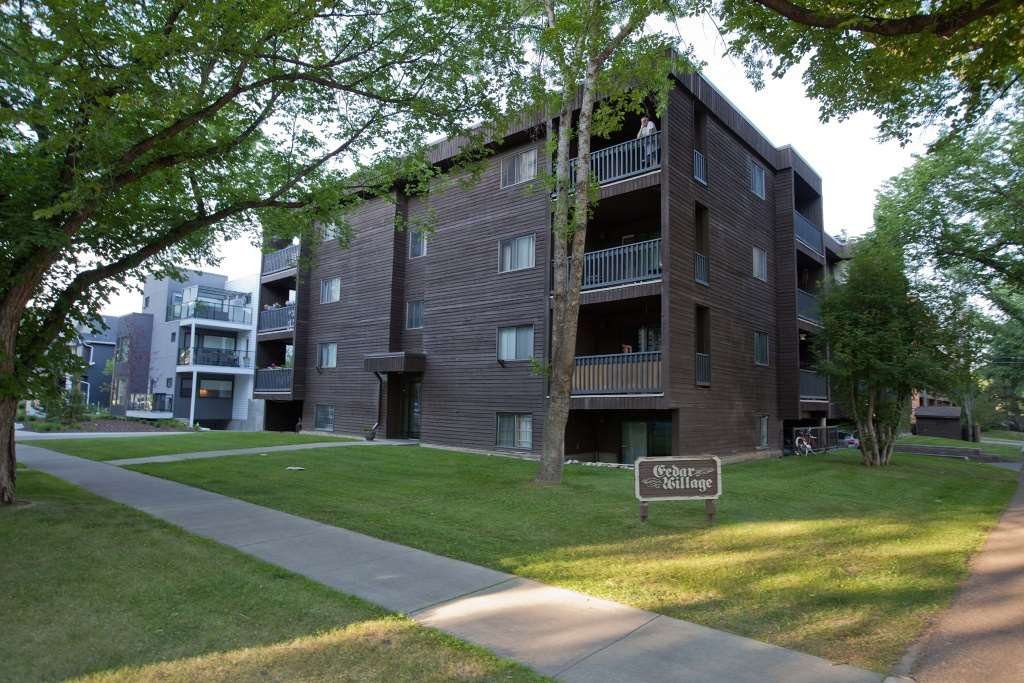Very nice, upgraded one bedroom condo in an excellent location. This immaculate home is situated in Cedar Village, a well run condominium with a large Reserve Fund. It is in an ideal location, close to Oliver Square, the Brewery District, Grant MacEwan College, and downtown Edmonton. This corner unit has a sunny west exposure, with a nice patio to enjoy summer days. The suite offers a very large living room with a fireplace, and sliding doors to the patio. The well designed kitchen opens to the dining room, and all appliances are included. Also there is free laundry included. The large bedroom has a big closet with organizer & mirrored doors. The bathroom is upgraded with granite counter, and newer ceramic tile, light, mirror, and toilet. The condo is all laminate and ceramic tile flooring, with new baseboards, and has been freshly painted throughout. There is handy in-suite storage, and one parking stall (#3) is included. Overall an ideal home for someone looking for comfort, convenience and security.