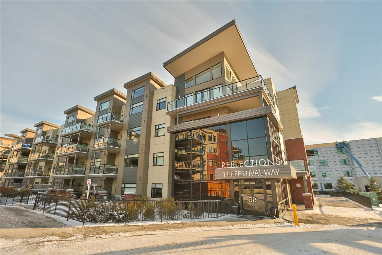 Visit Realtors website for more information. LUXURY living in the HEART of Sherwood Park! This SOUTH facing TOP FLOOR executive condo features 2 bedrooms and 2 bathrooms in the Reflections building. Bright and spacious floor plan, with laminate through out the main living area. Upgraded kitchen with white cabinets, granite counter tops, glass backsplash,  black appliances, and opens to the spacious dining area. The living room features Cathedral ceilings, plus a huge south facing window and garden door to your SOUTH facing patio with views of Prairie Walk, Festival Place and Broadmoor Lake. Comfortable master suite with walk in closet and 4pc ensuite, second bedroom, 4pc bathroom and large laundry area with tons of storage complete this AIR CONDITIONED home. Underground parking and storage cage included with the option to buy or rent additional stalls. AMAZING location!!! Walking distance to parks, farmers market, and a front row view of fireworks!
