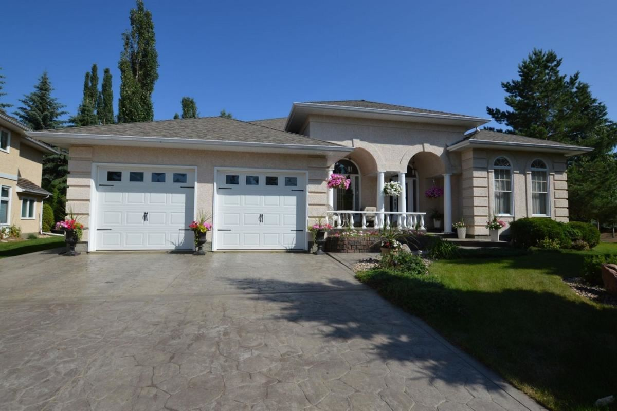 Exceptional quality describes this unbelievable 2850 sq.ft. bungalow.  Featuring hardwood, ceramic floors, 2 gas fireplaces, 10'x13' ceilings, 2 jacuzzies, large 2 man steam shower and  top of the line fixtures. Home has a newer roof, 2 newer garage doors and 2 newer hot water tanks.  Shows 10 all the way.  Outstanding location on a huge private treed pie shaped lot at the end of a cul-de-sac.  The professionally landscaped yard features a water fall, sprinkler system and park like setting.  This west coast designed home was custom built by Mourne Homes.  Show and sell with confidence.
