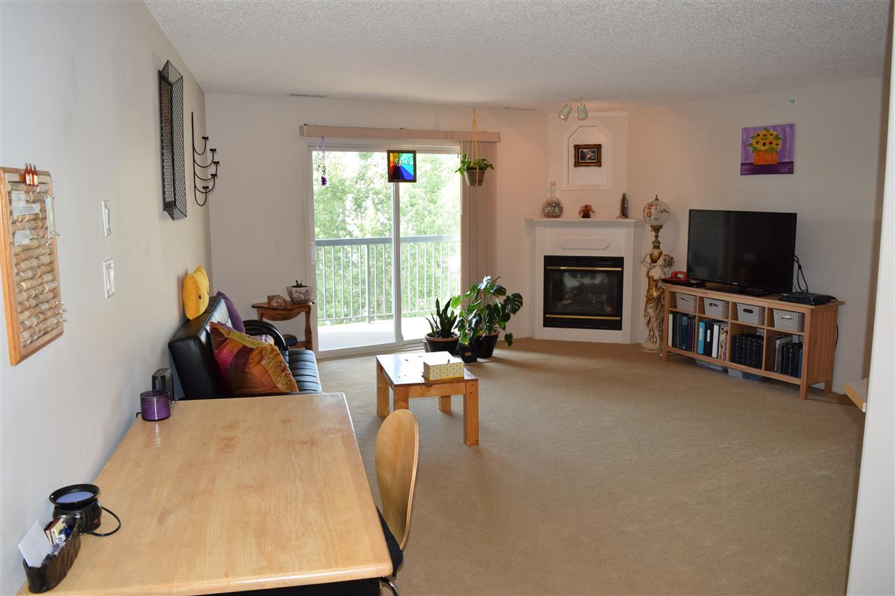 Spacious and AIR CONDITIONED,Top floor 1 bedroom condo for unbeatable price! Featuring New laminate and carpet flooring throughout, gas fireplace, huge laundry room with stand up freezer. Deep soaker tub in the bathroom and tons of storage. Underground heated title parking with storage cage and low condo fees include heat, water, EXERCISE ROOM and more!Must see! Great value!