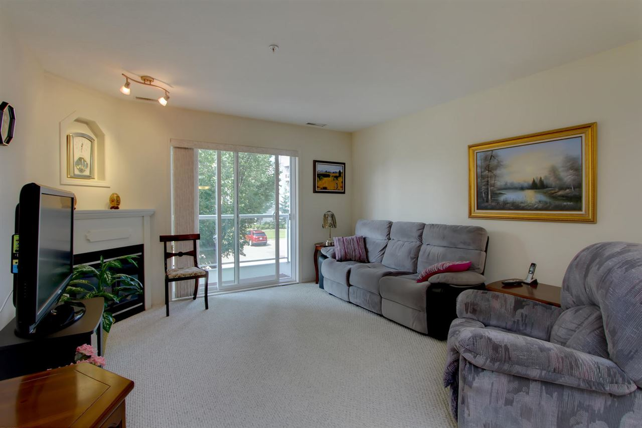 This unit is facing west but has trees to shade your balcony. The large living/dining room are bright and the corner gas fireplace is a nice focal point.