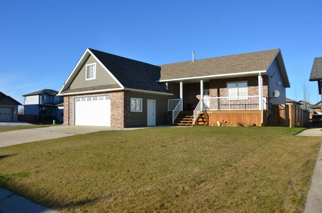Stunning 1630 sq ft Executive Bungalow privately located at edge of cul de sac on large fenced corner lot in Barrheads premier subdivision of Beaver Brook Estates. High ceiling open vault main living area includes quality features including hardwood floors, three sided gas fireplace, Solid oak custom cabinetry w/ high end appliances and corner pantry. Large master bedroom with double closets and 3 pc ensuite. Bonus den/ theater room above garage. Convenient Main floor laundry. Over sized and insulated double car garage. Basement features Large recreation room, storage and 3 additional bedrooms plus a full 4pc bath. Excellent stature and curb appeal including covered front sitting porch and large back BBQ deck off dining room. Much more to see and feel for yourself. Don't delay.