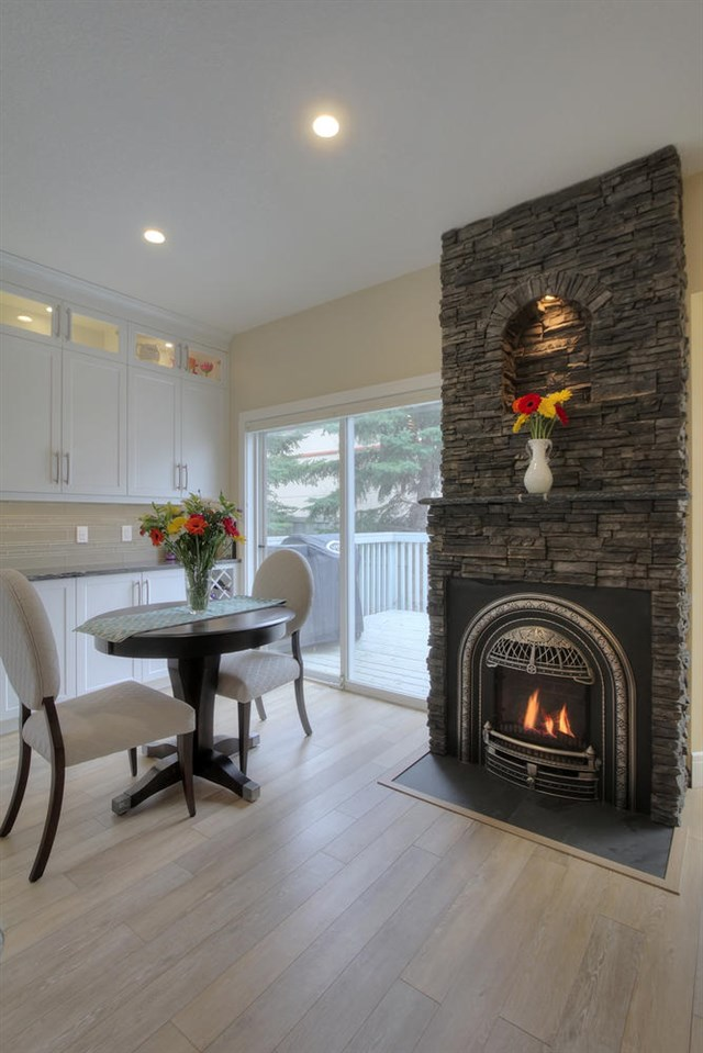 Craftsman talent was used to build this interesting gas fireplace that replace an old fashioned triple sided fireplace that took up way too much space. This unit has a remote to control all the features.