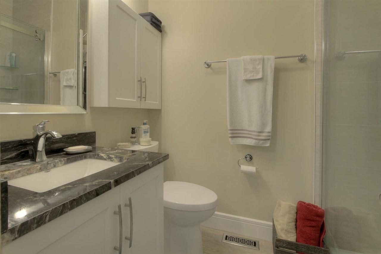 The main bathoom has a nice generous sized shower stall.